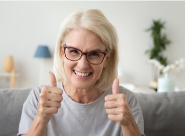 excited woman giving two thumbs up