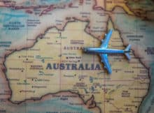 model airplane sitting on a vintage map of Australia