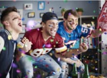 very excited friends watching the Super Bowl together