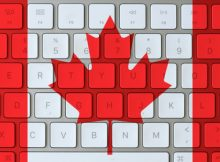 Canadian flag super imposed on the keyboard of a laptop